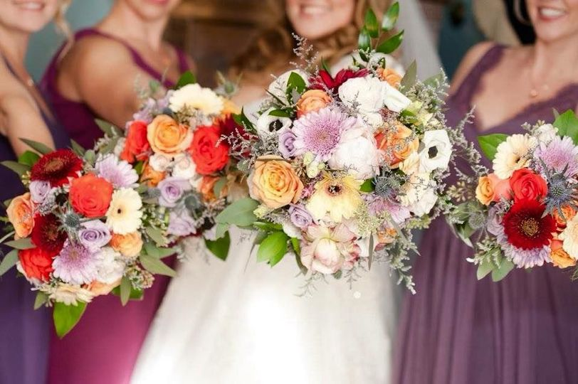 Bridal and bridesmaids bouquets done in a fall/pastel color scheme.