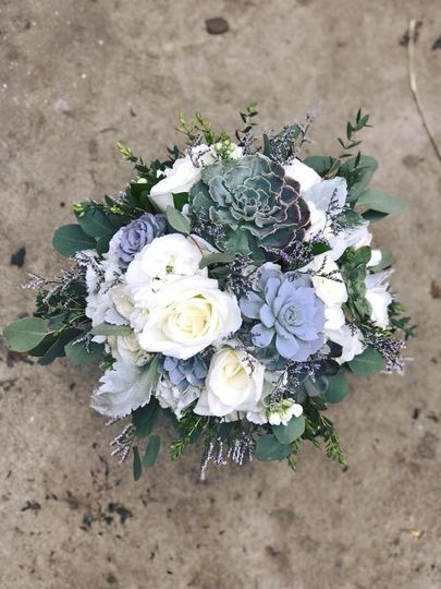 Bridal bouquet as seen from above. Succulents with roses for an early spring wedding.