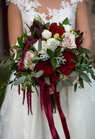 Slightly cascading bridal bouquet with blushes, ivories and burgundy accents.
