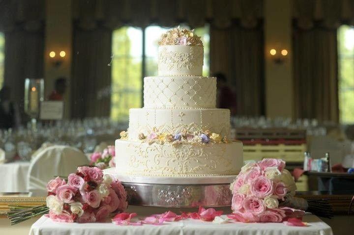 Bouquets around wedding cake