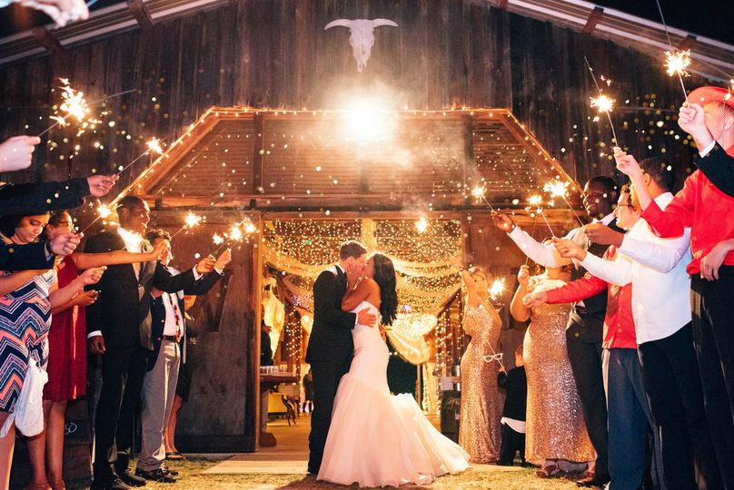 barn wedding with sparklers at the wishing well ba