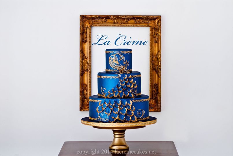 A blue peacock inspired cake created as the centerpiece for a lovely Indian style wedding.