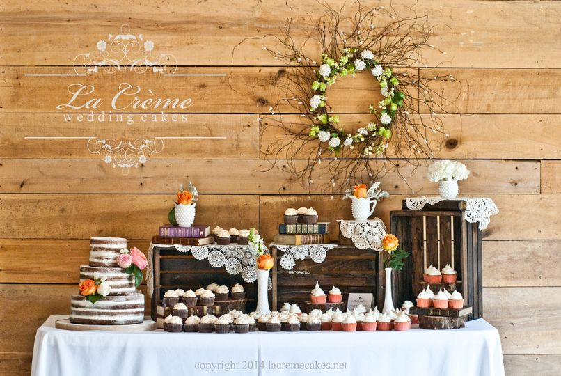 "A delightful ""naked"" cake and delicious cupcakes for a rustic style wedding."