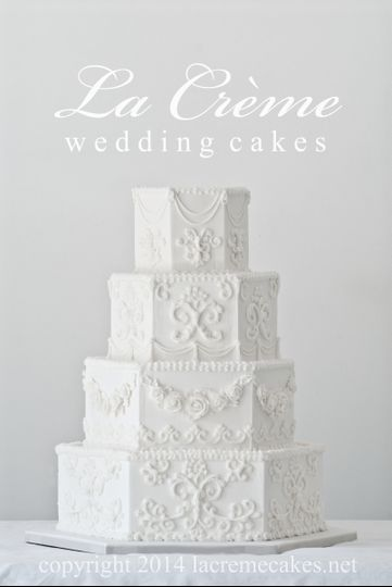 This victorian style hexagon wedding cake is a buttercream work of art.