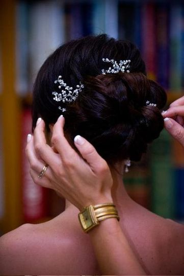 This bride has a hairpiece in to add fullness and color to her hair.  She looked amazing...