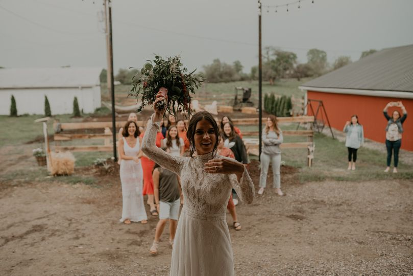 Bride throwing boquet