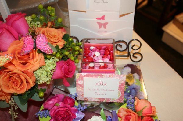 Spring/Summer wedding featuring Monogram placecard, pocket invite, and favors.