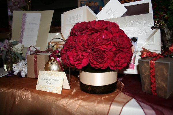 Winter wedding featuring reds, golds and ivory. Picture includes favor packaging, invite samples and...