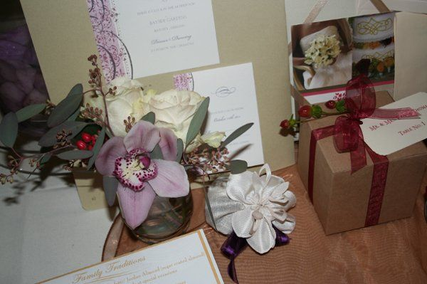 Tropical wedding featuring orchids, lavendar satches and recycled paper, soy-based invitation.