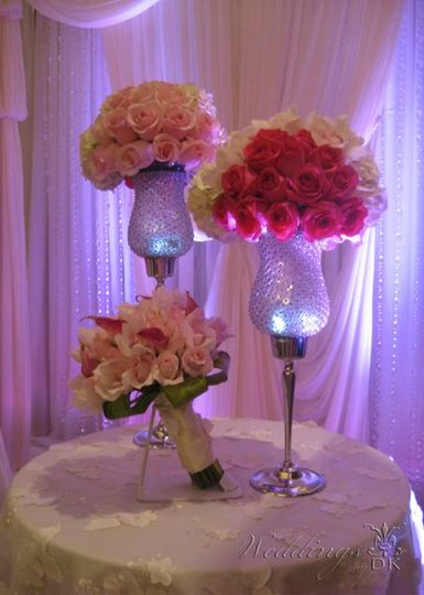 Bouquets, Centerpieces, Linen and Lighting by Weddings by DK