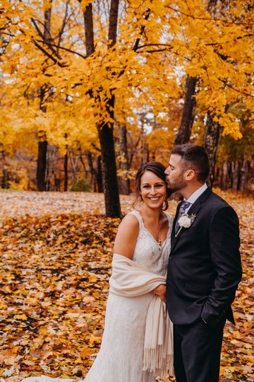 Bride and groom by the autumn leaves