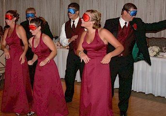 Groomsmen and bridesmaids in blindfolds