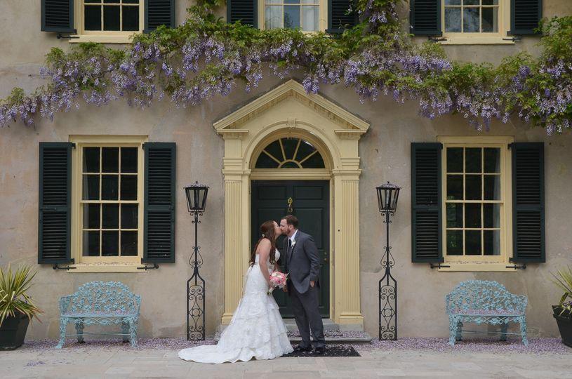 Newlyweds under wisteria