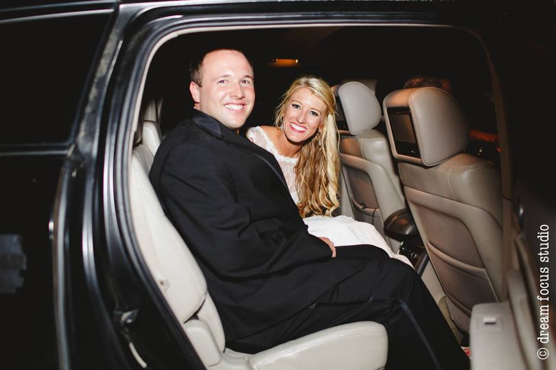 bride and groom in suv