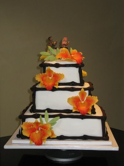 This Hawaiian Style fondant wedding cake was specially made for  a very sweet couple, Cassandra and...