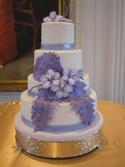 Cake specially made for Brandon and Jun, 4 tiers Gourmet whip cream, decorate with lavander fondant...