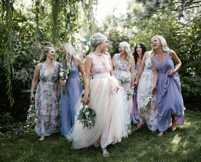 Bride and bridesmaids in lovely dresses