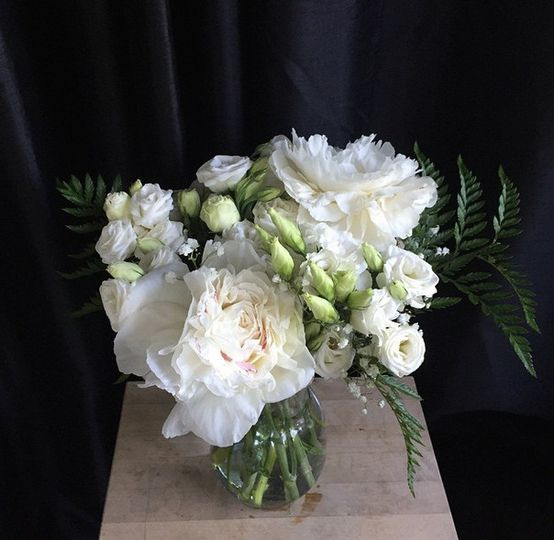 White peony and roses for simple and classy centerpiece.