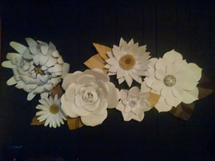 "Giant Paper Flowers, great as a back drop or table centerpieces, or accents. Sizes range from 4"" to..."