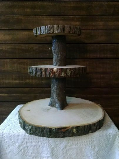 "Three tier log slab stand. Approximately 24"" tall, base is 18"" in diameter. Perfect for that rustic..."