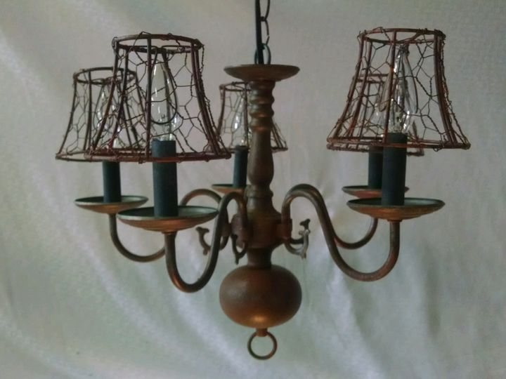 5 light chandelier, painted to look rusted. Chicken wire light shades. Plug in.