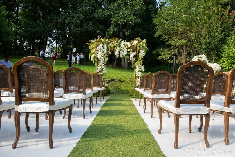 Ceremony chairs and floral arch