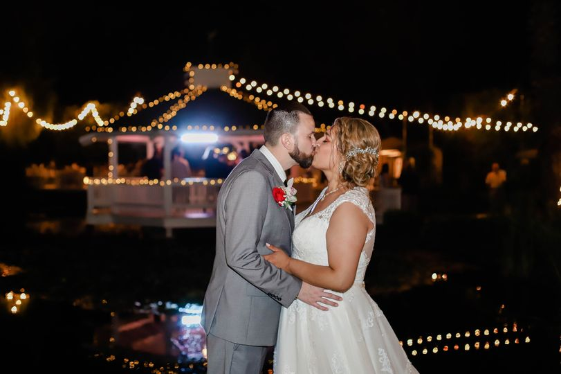 Couple kiss under glowing lights
