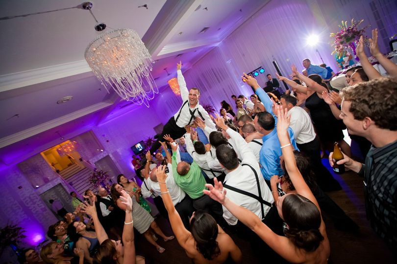 Crowd surfing groom
