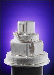 A textured fondant cake featuring a bold monogram.