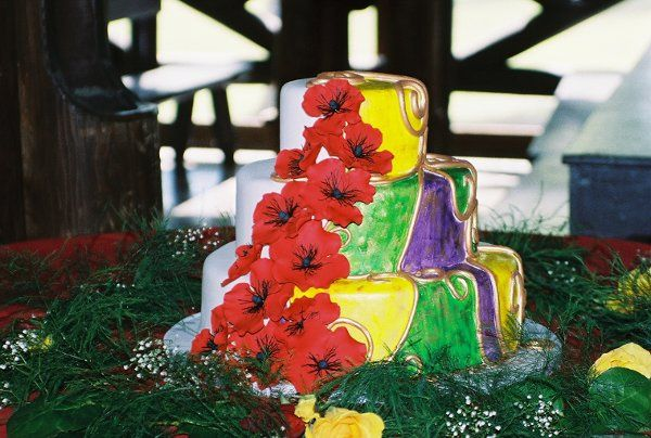 A brightly painted cake with handmade sugar poppies inspired by several works by Gustav Klimt.