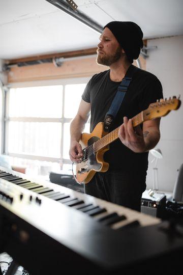 Guitarist rehearsing