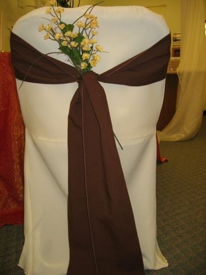 Ivory chair cover with complimentary Chocolate chair tie.
