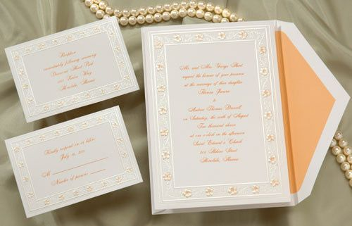 Summer wedding invitations feature tropical flowers. Delicate tangerine hibiscus accent the border...