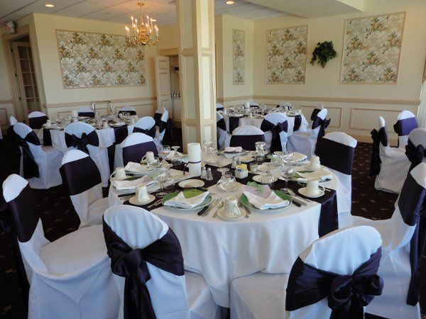 white standard covers w/ plum satin sashes and plum table runners