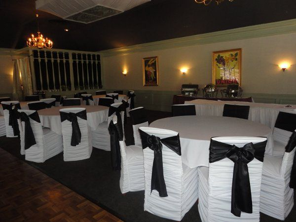 white rouge chair cover w/ black satin sashes
