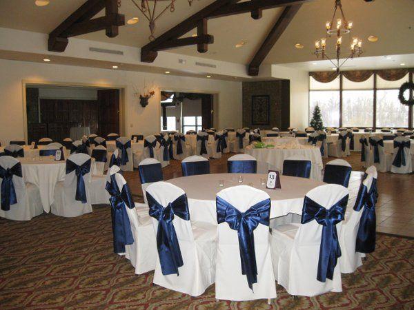 white chair cover w/ navy blue satin sashes