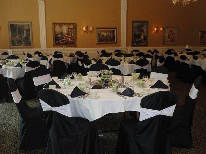 Tmx 1364243861393 Blackstandardchaircoverswithwhitandivorybands004 North Tonawanda wedding rental