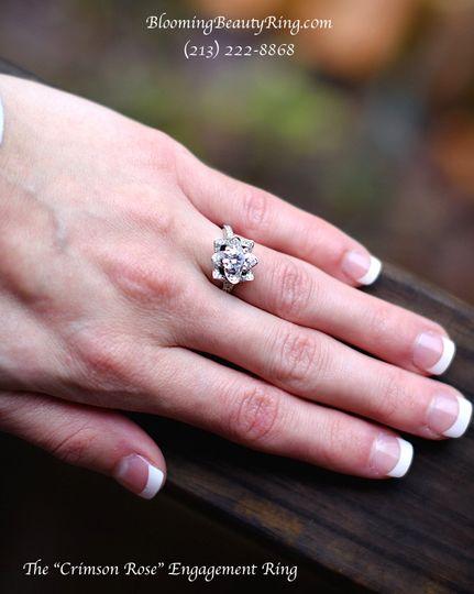 crimson rose unique engagement ring on hand