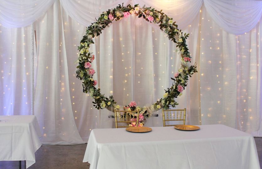 White back drop w/ floral ring