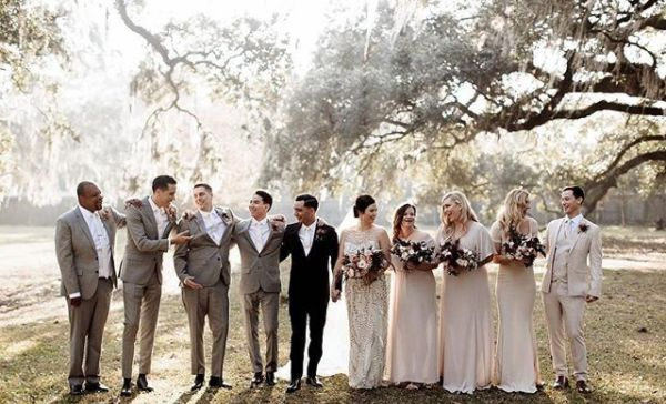 Newlyweds, bridesmaids, and groomsmen