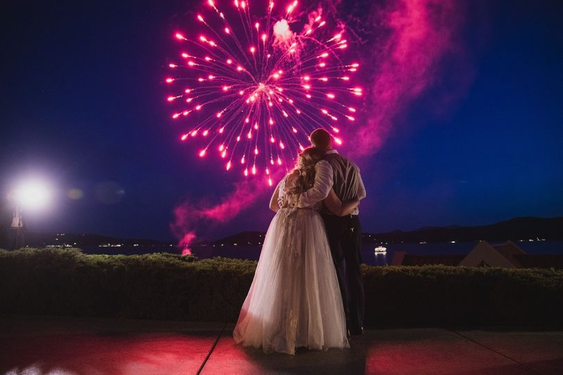 Romantic embrace with fireworks