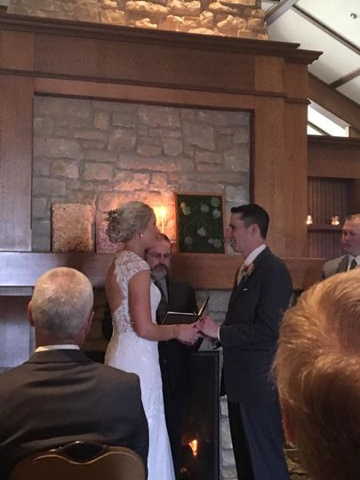 Vows by a fireplace