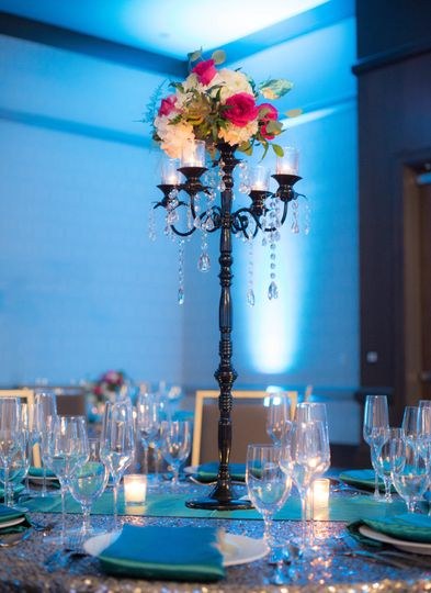 Table set-up with lantern and flower centerpiece
