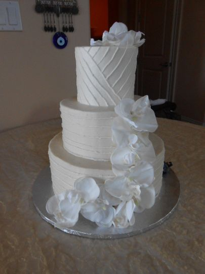 3-tier white flower wedding cake