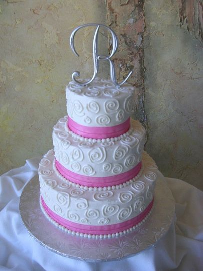 3-tier wedding cake with pink detailing