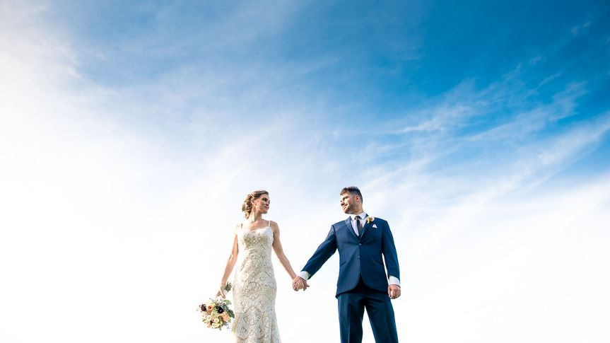 Couple holding hands - Tall + Small Photography