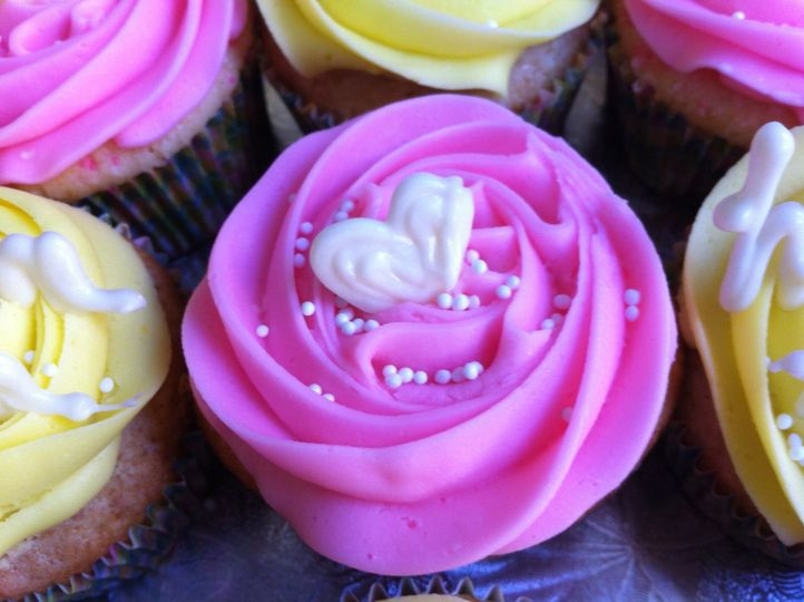 Stay Sweet Cupcakes - Pink - Sweet white almond cake with pink batter bits, topped with almond...
