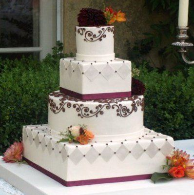 Mixed shape, scrollwork and harlequin pattern fondant-covered cake