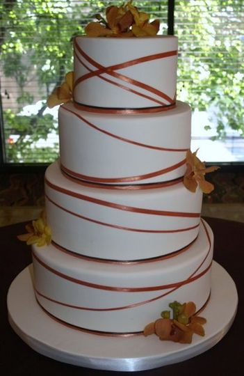 Ribbon Wrap Cake in Fall colors: burnt orange and chocolate brown.