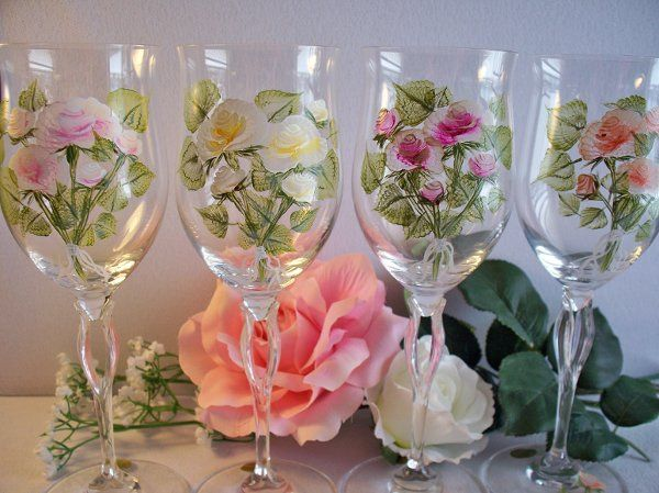 Each glass in this set of 4 Bliekristal has a different color rose in the boquet